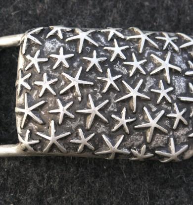 Gürtelschließe, grau mit Sternen, antik